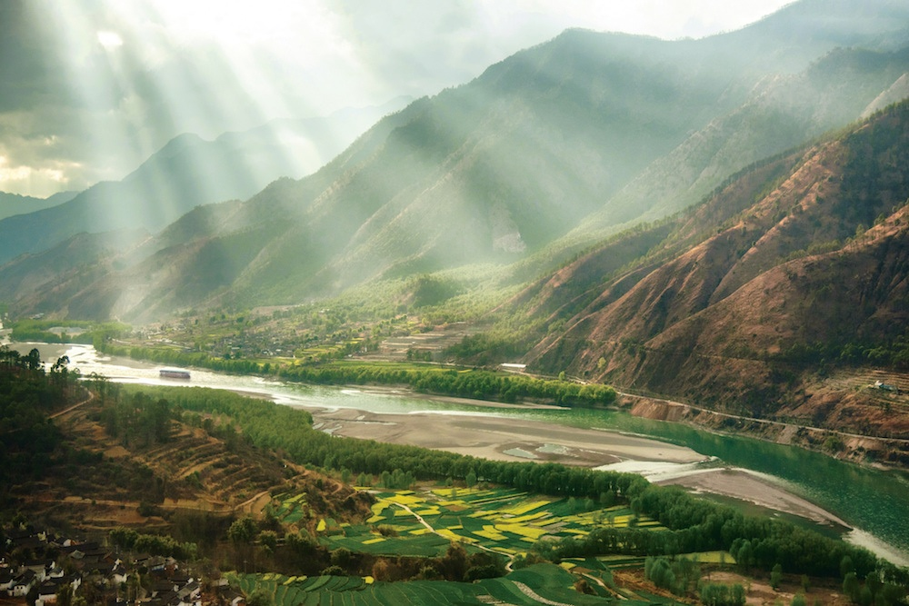 River cruising through Laos landscapes