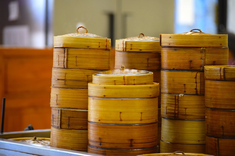 Dim sum cart with steamed dishes in baskets